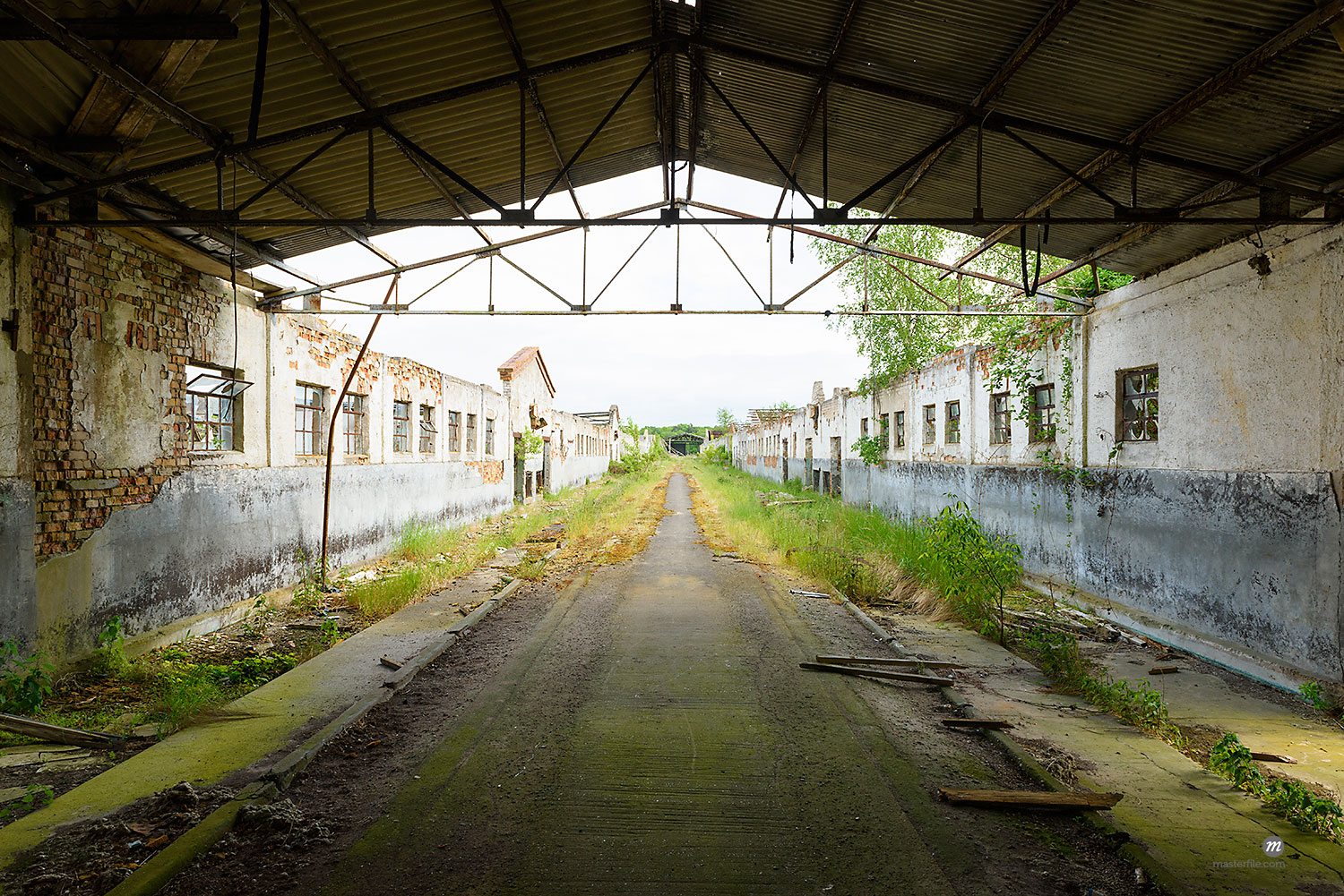 Roof framework over road and old decayed buildings in Mecklenburg Vorpommern, Germany  © © Michael Breuer / Masterfile