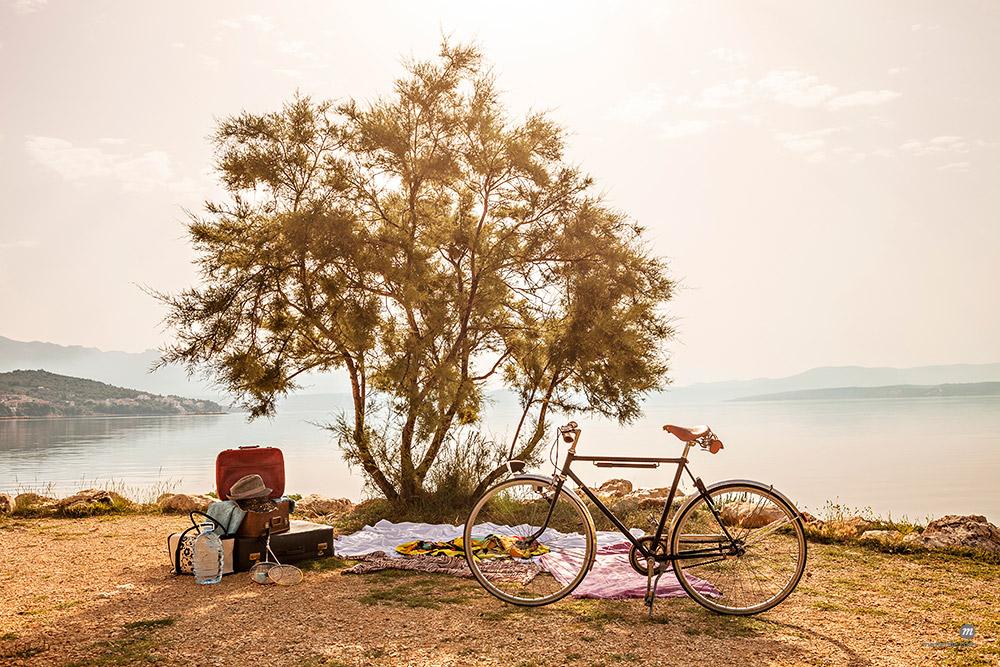 Croatia, Dalmatia, Picnic at the seaside, bike in foreground © Masterfile