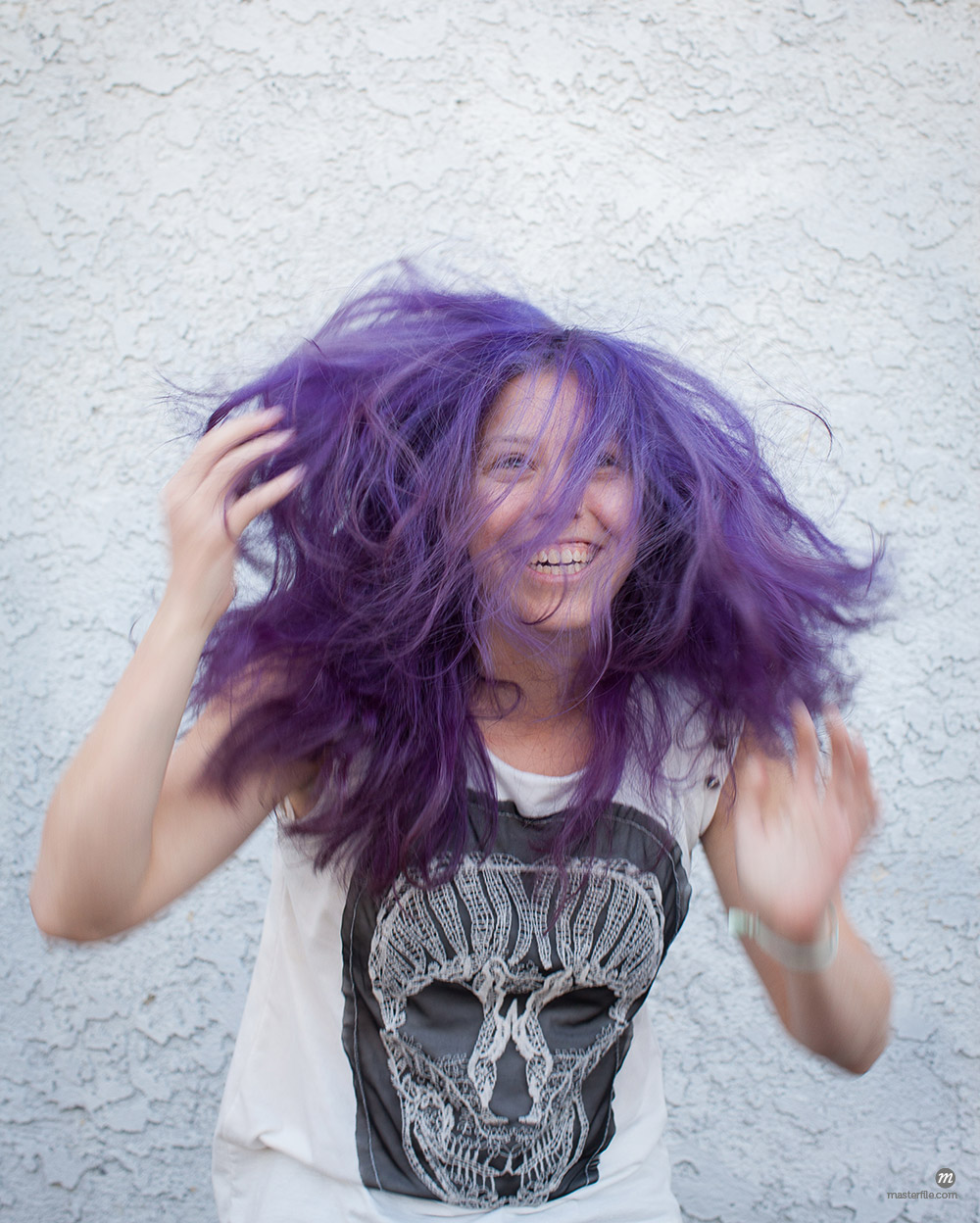 Young woman wearing purple wig © Masterfile