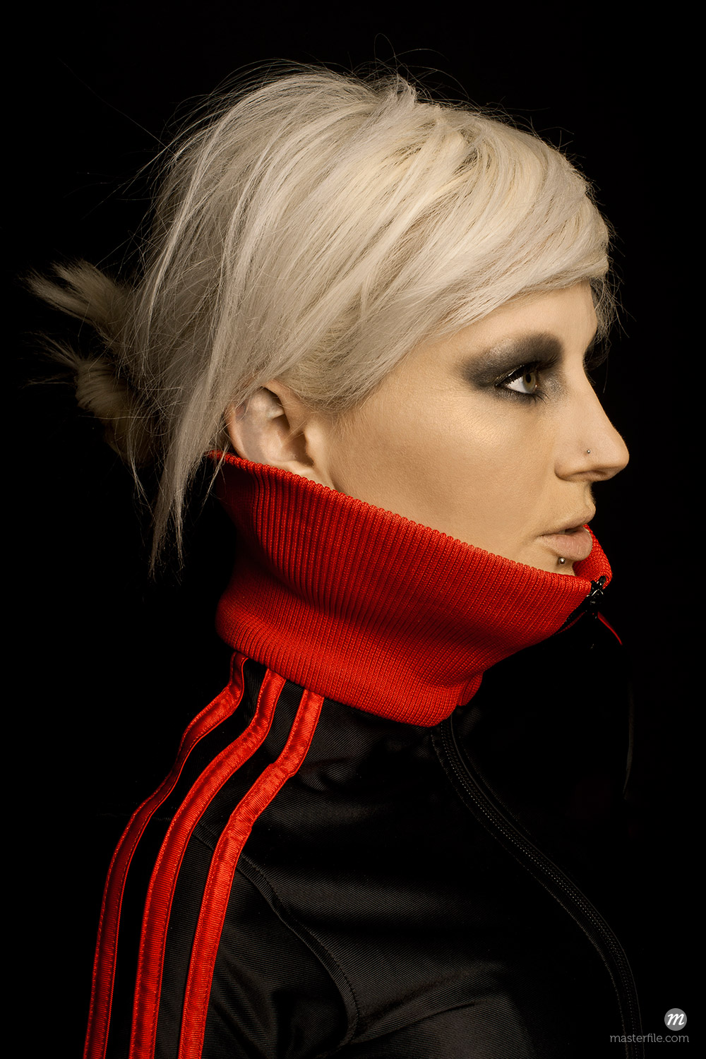Portrait of Blond Woman Wearing Shirt with Red Collar © Shelley Smith / Masterfile