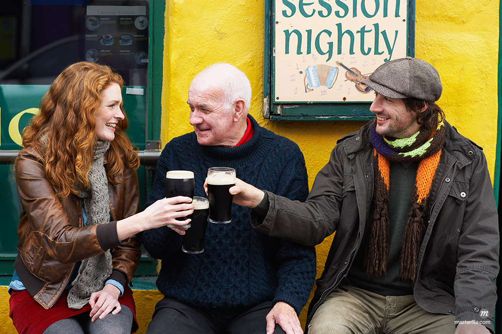Couple and Man by Pub, Ireland © Masterfile