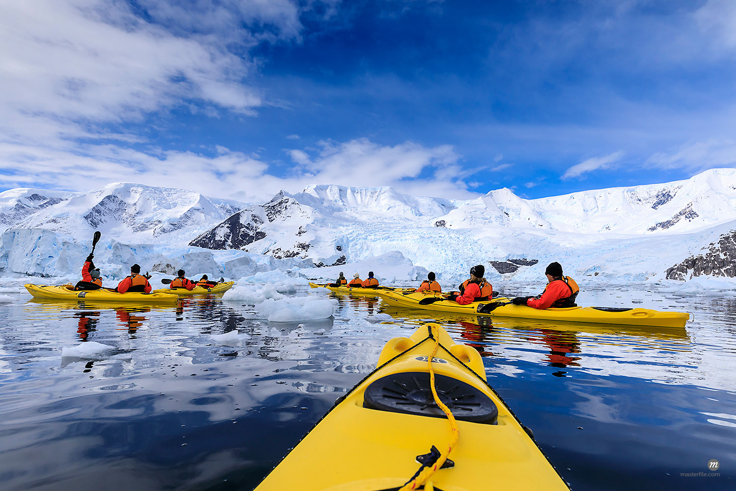 Kayaking amongst spectacular icebergs, mountains and glaciers, sunny Neko Harbour, Anvord Bay, Antarctic Peninsula, Antarctica, Polar Regions  © robertharding / Masterfile