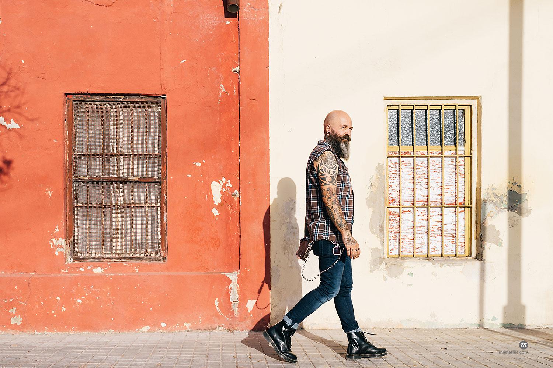 Mature male hipster walking along sidewalk  © Masterfile