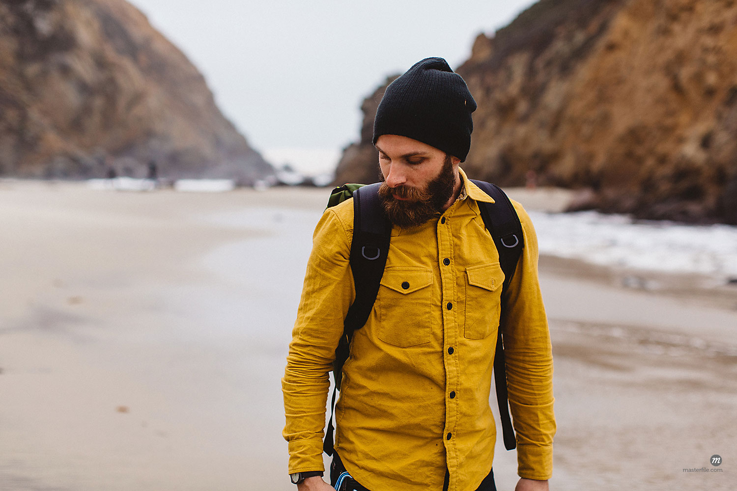 Male hiker walking on beach in Big Sur, California, USA  © Masterfile