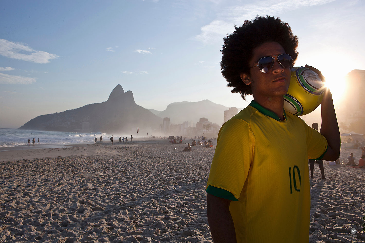 Young man at the beach with football, Ipanema Beach, Rio, Brazil  © Masterfile