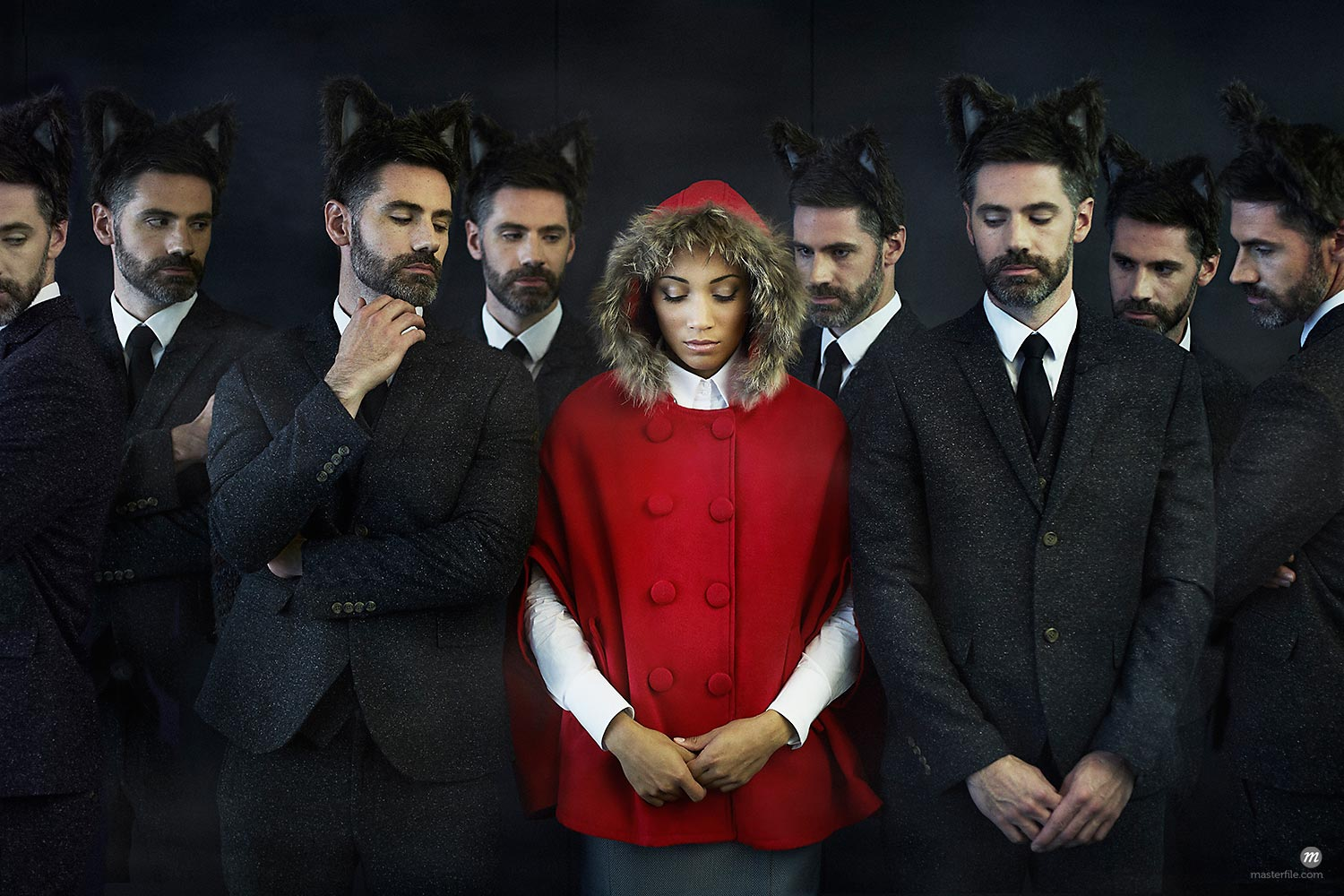 Woman dressed as little red riding hood with businessmen, multiple image  © Masterfile