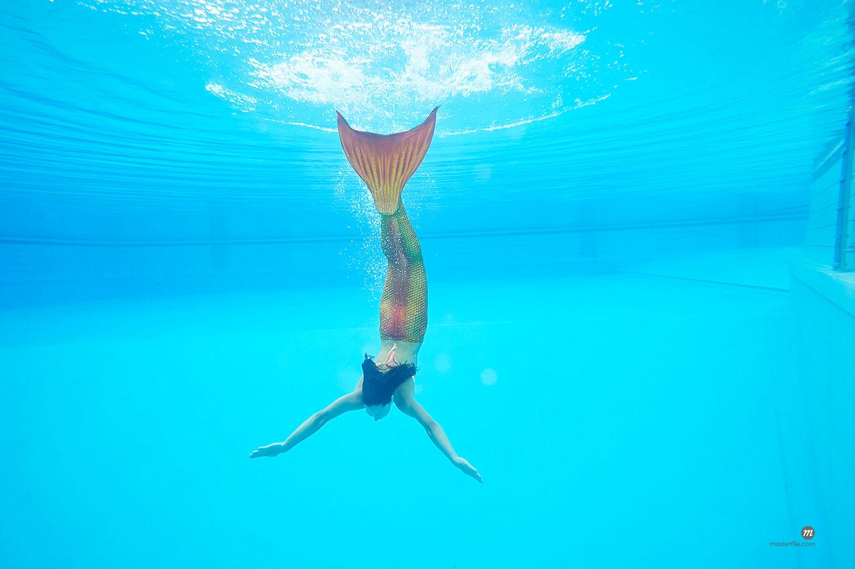 Portrait of Teenage Girl with Mermaid Tail Underwater  © David & Micha Sheldon