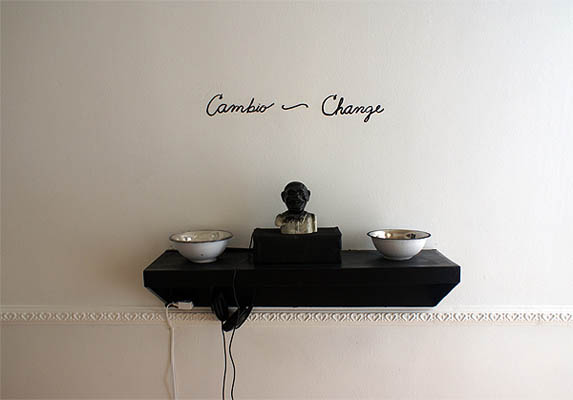 Cambio/Change      2009, automatic bank, bowls of Mexican and US currency, audio