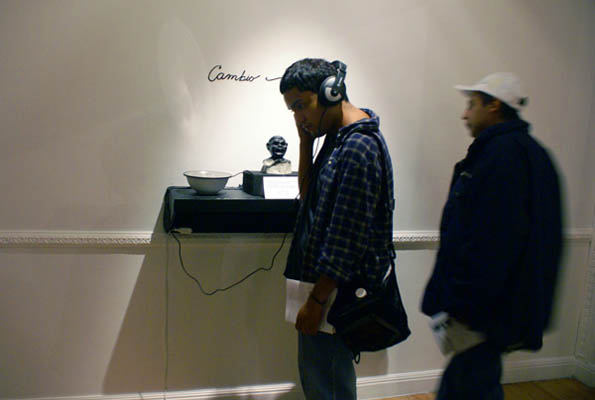 gallery visitors engage with  Cambio/Change ,  listening to snippets of Holly's stories and songs