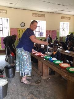 Heather helping to serve porridge and beans.