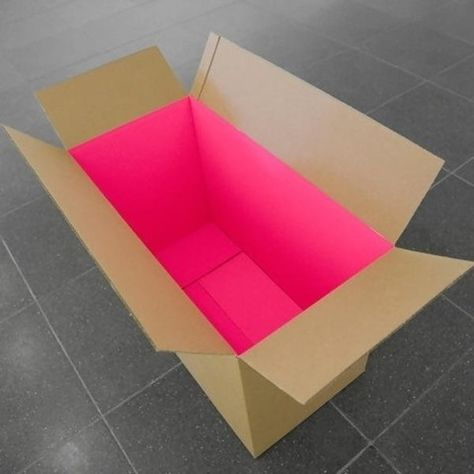 NOT THE PINK, BUT RATHER THE CONTRAST OF CARBOARD AND COLOUR, AND THE SURPRISE FACTOR.