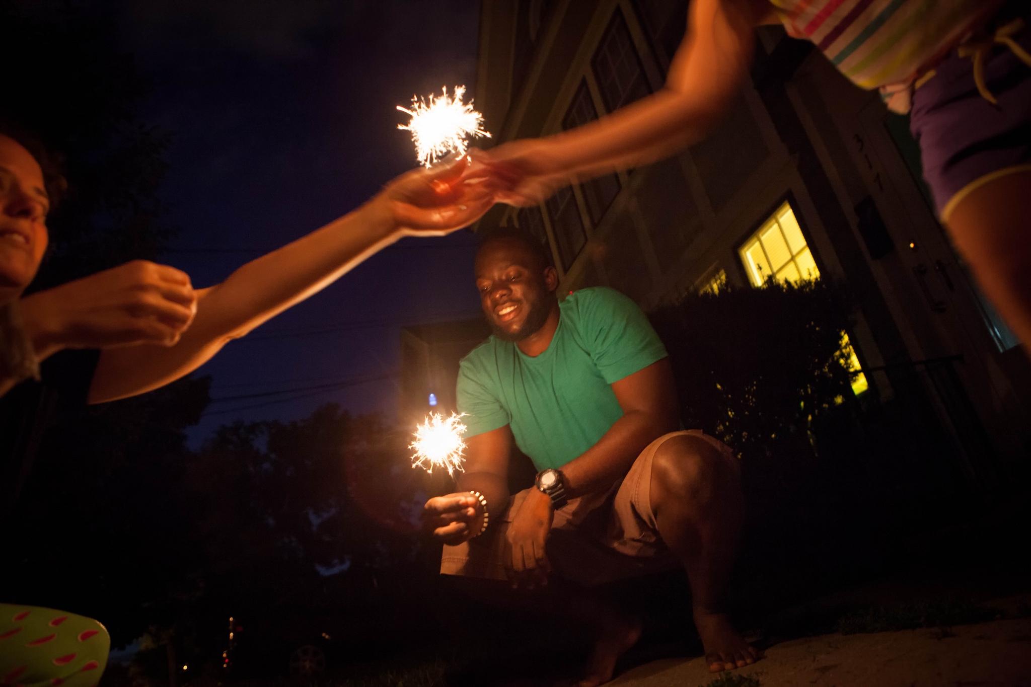 Chase Walker, center, enjoys his first Fourth of July fireworks with his host family, The Harpers in Syracuse New York.
