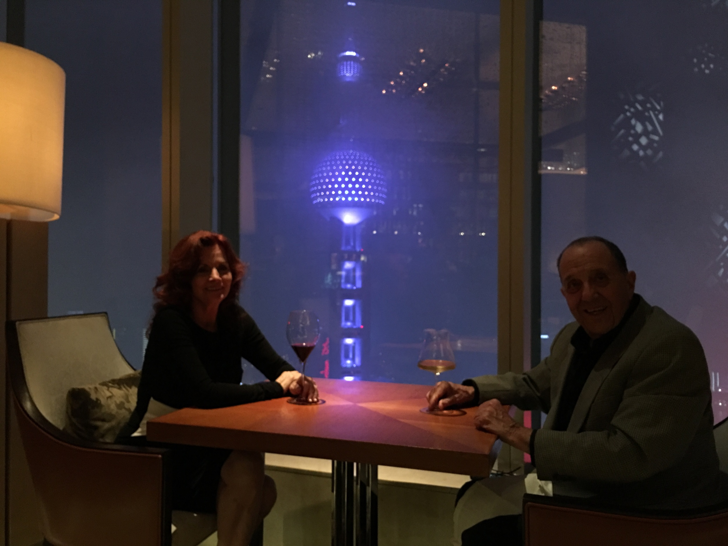 Johnny, our waiter, came by and said we had to have another picture since the Oriental Pearl Radio & TV Tower was visible now.  The people of Shanghai consider this their Eiffel Tower.
