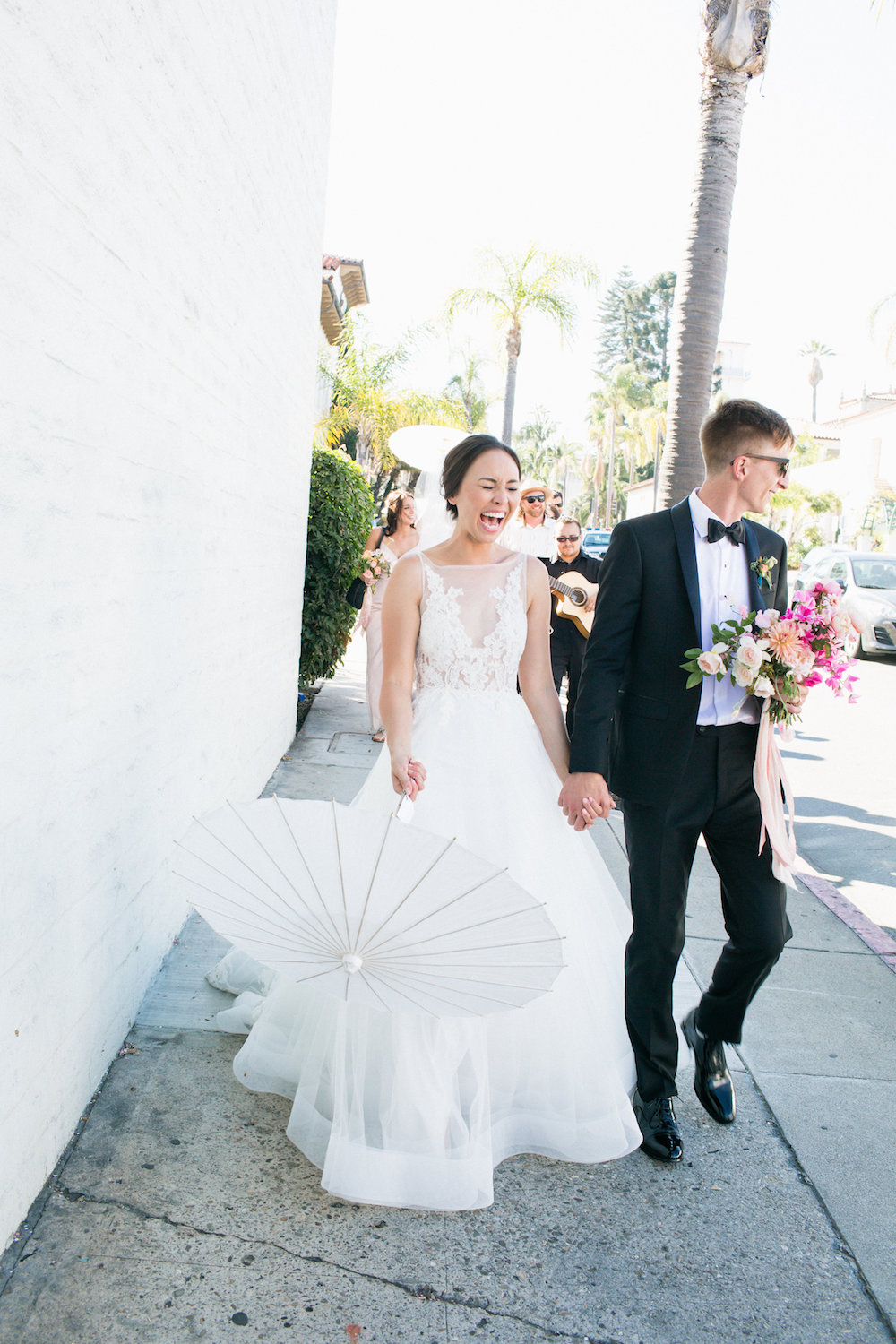 Melanie & Dylan paraded through the streets of Santa Barbara after their wedding ceremony.  Photo by Max & Friends.  Event Design by Carly Rae Weddings.