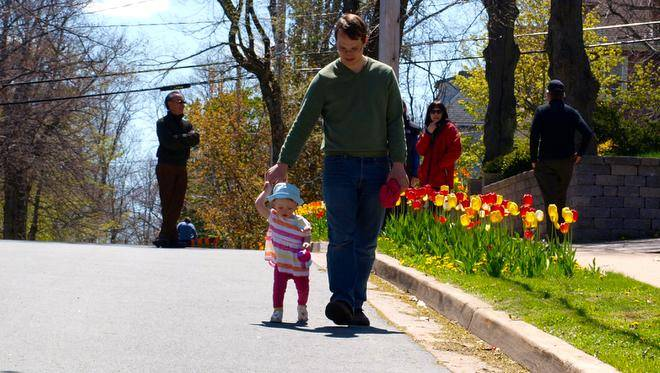 Founder, Sam Austin with his Daughter on Tulip Street. Image Courtesy of  The Chronicle Herald