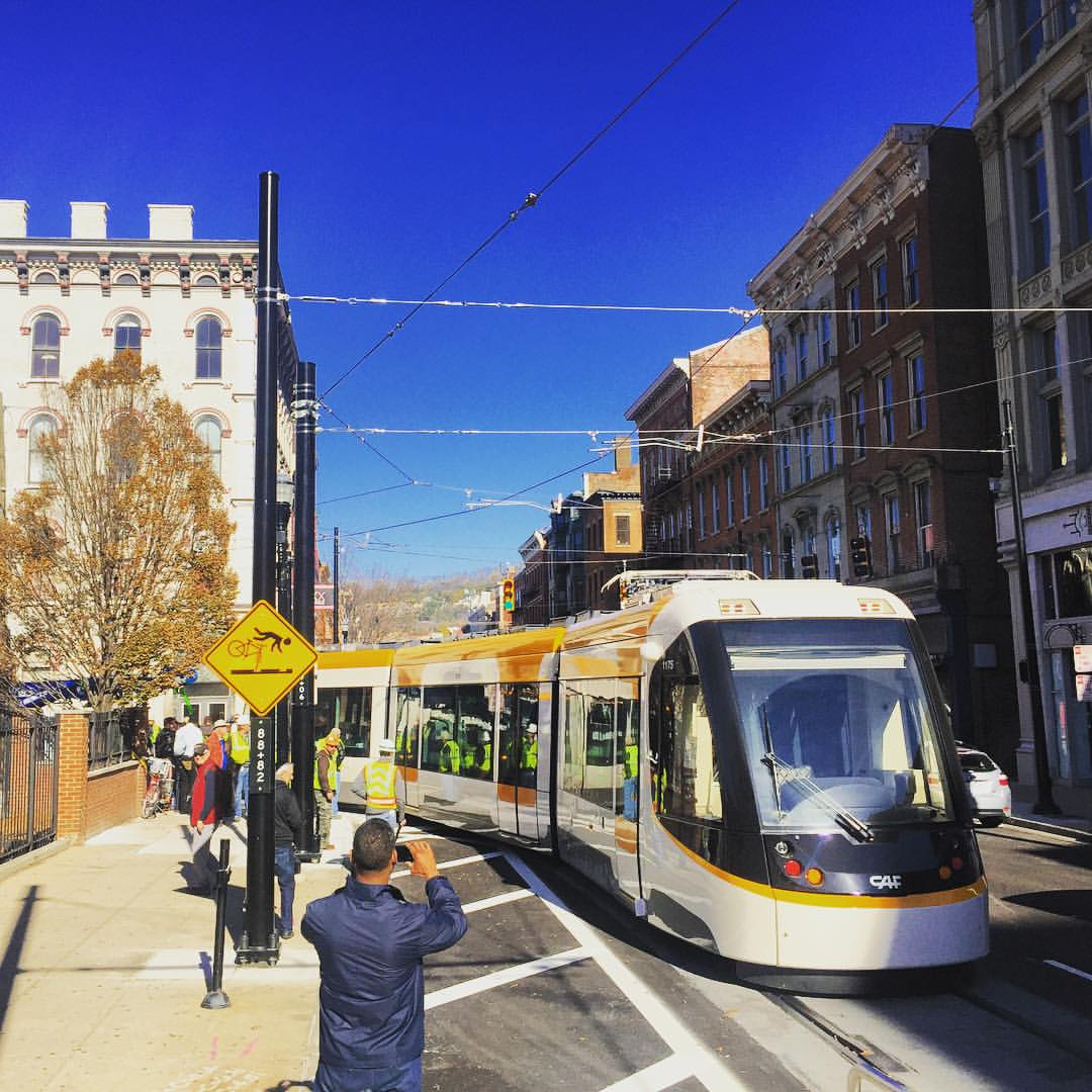 Cincinnati's first modern streetcar hits downtown streets. It is the first of 5 cars to be delivered over the coming months.