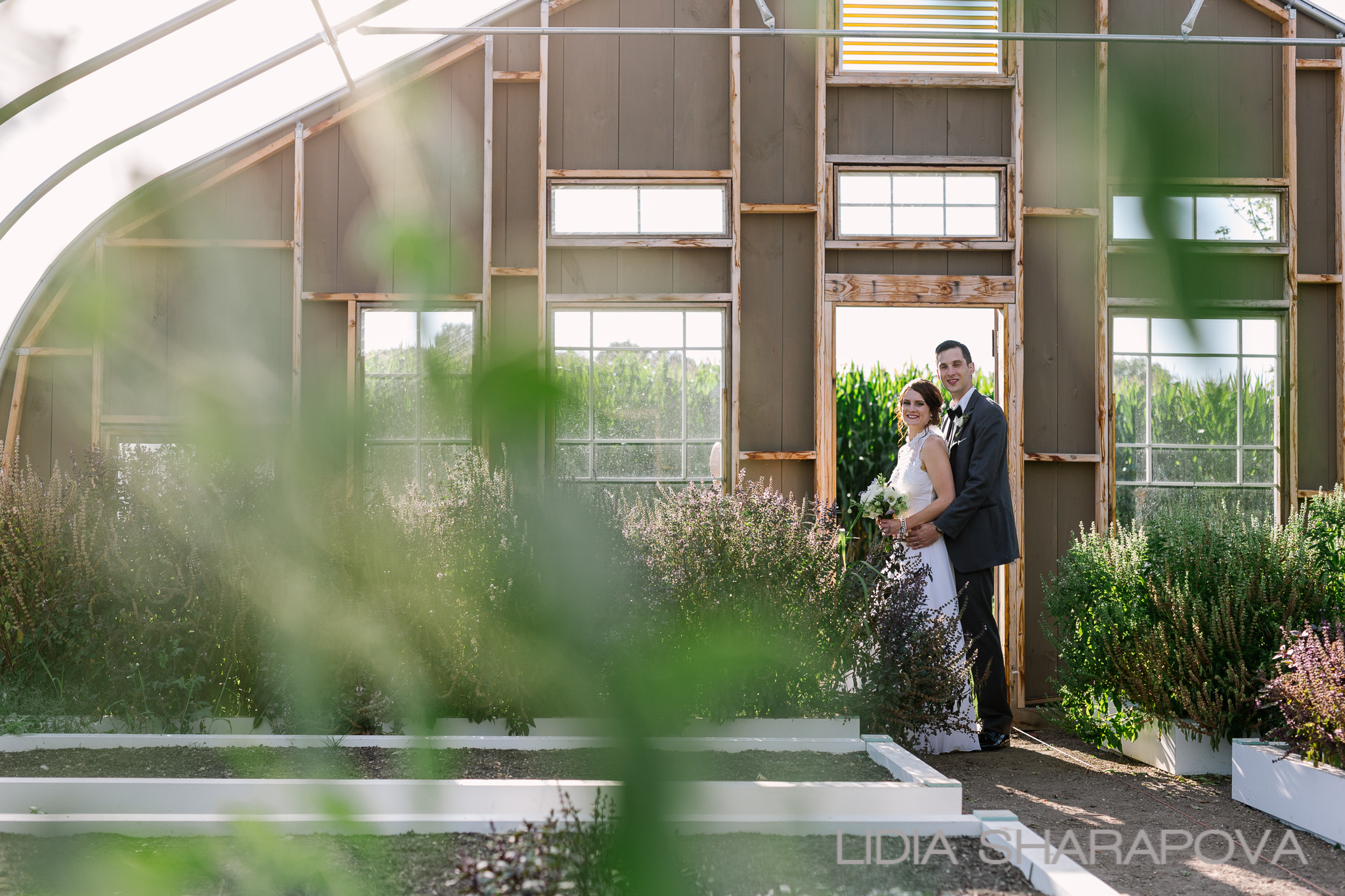The farm's architectural hoop house is a beautiful backdrop.  Image by   Lidia Sharapova