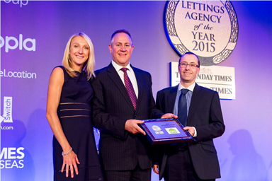Pictured: Paula Radcliffe, presenting Julian Foster and Daren King of The DPS with the award