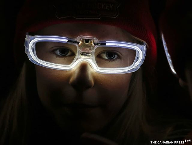 A young girl wears LED glasses while waiting for Prime Minister Justin Trudeau to arrive at the Wickenheiser World Female Hockey Festival in Calgary, Alta., Thursday, Nov. 22, 2018.THE CANADIAN PRESS/Jeff McIntosh . . . . . #yyc #eyes #LED #Calgary #ctwickfest@wickfest#WickFest2018#WickFest#HockeyLife#HockeyMom#Hockeymoms#hockeycalgary#yychockey#winsport @hchickwick
