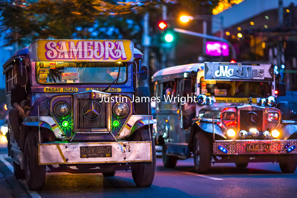 Passenger Jeepneys, Makati City, Metro Manila, Philippines   Philippine Image # 4012  If you wish to purchase a photography print of this image, or would like to license this image please contact us using the form below.  Please kindly include the Image Title and Image Ref # in your message, we will get back to you.