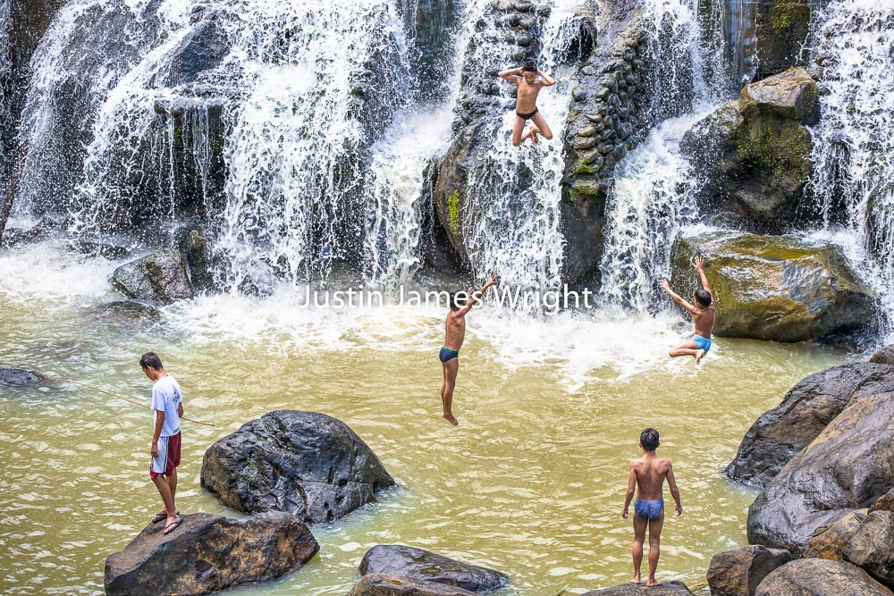 Children Jump Over a Waterfall, Cavinti, Laguna, Philippines   Philippine Image # 4025  If you wish to purchase a photography print of this image, or would like to license this image please contact us using the form below.  Please kindly include the Image Title and Image Ref # in your message, we will get back to you.