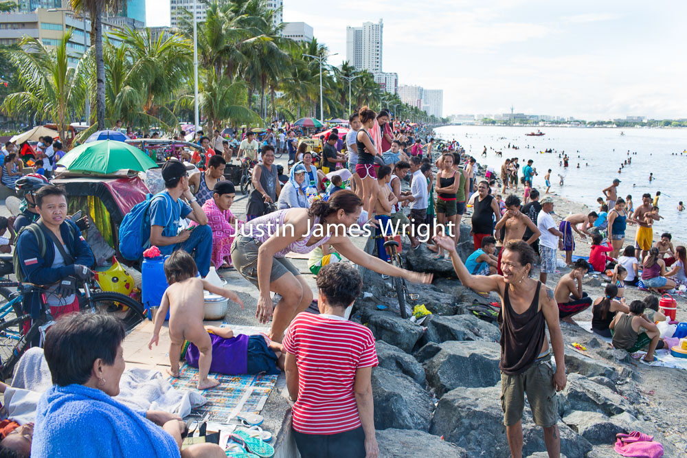 Easter Sunday Celebrations by the Bay, City of Manila, Philippines   Philippine Image # 4125  If you wish to purchase a photography print of this image, or would like to license this image please contact us using the form below.  Please kindly include the Image Title and Image Ref # in your message, we will get back to you.