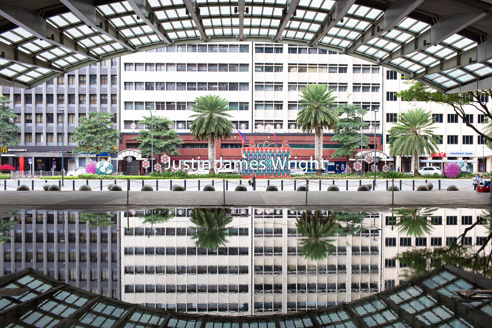 Title:  Reflections, Ayala Triangle, Makati City, Metro Manila, Philippines   Philippine Image # 4146  If you wish to purchase a photography print of this image, or would like to license this image please contact us using the form below.  Please kindly include the Image Title and Image Ref # in your message, we will get back to you.