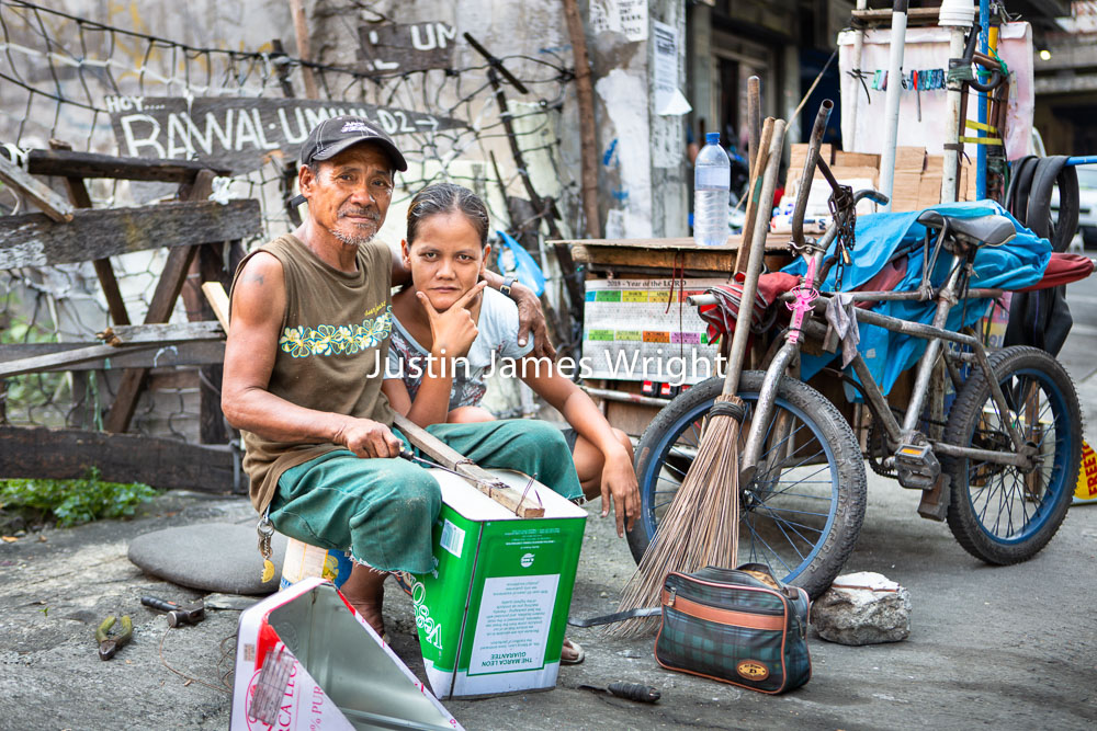 Dust-Pan Maker and His Wife, Pasay City, Metro Manila, Philippines.   Philippine Image # 4191  If you wish to purchase a photography print of this image, or would like to license this image please contact us using the form below.  Please kindly include the Image Title and Image Ref # in your message, we will get back to you.