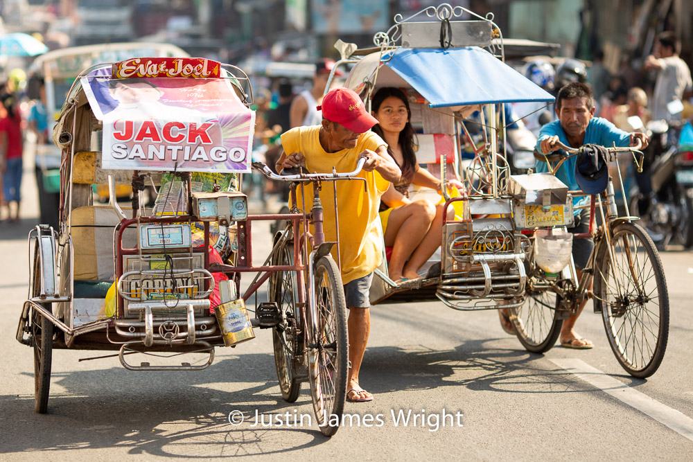 Pedicabs,, Malabon, Metro Manila, Philippines    A popular means of Public Transport in the Philippines   Philippine Image # 4198  If you wish to purchase a photography print of this image, or would like to license this image please contact us using the form below.  Please kindly include the Image Title and Image Ref # in your message, we will get back to you.