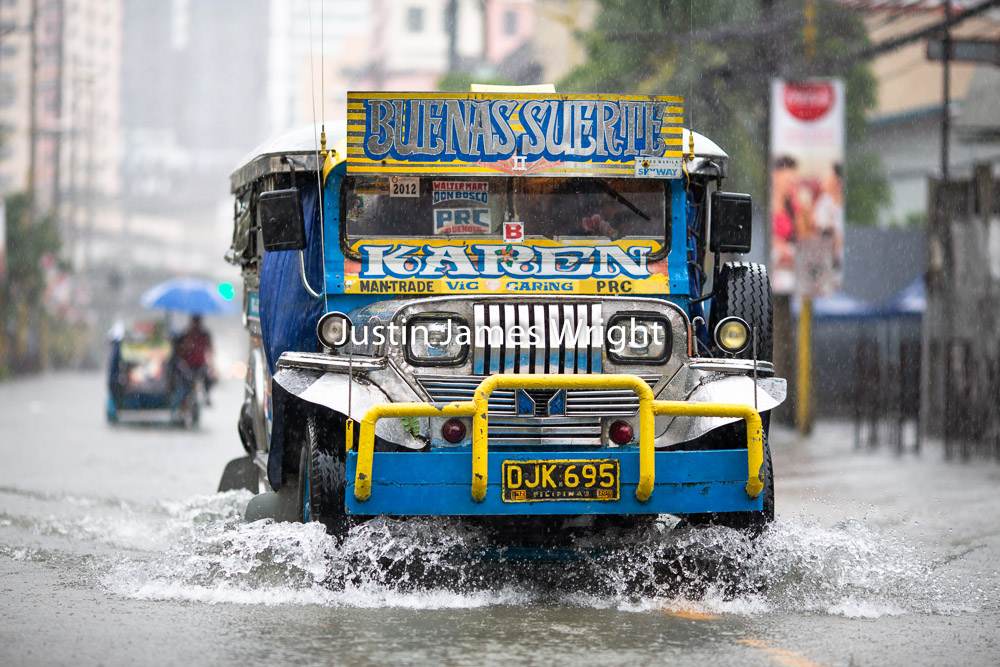 Passenger Jeepney on a Flooded Street, Makati City, Metro Manila, Philippines   Philippine Photo # 4228  If you wish to purchase a photography print of this image, or would like to license this image please contact us using the form below.  Please kindly include the Image Title and Image Ref # in your message, we will get back to you.