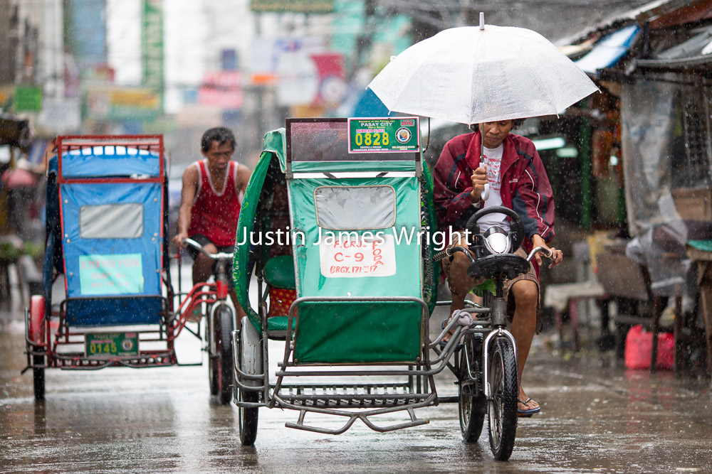 Pedicabs (Public Transportation), Malibay, Pasay City, Metro Manila, Philippines.   Philippine Photo 5246  If you wish to purchase a photography print of this image, or would like to license this image please contact us using the form below.  Please kindly include the Image Title and Image Ref # in your message, we will get back to you.