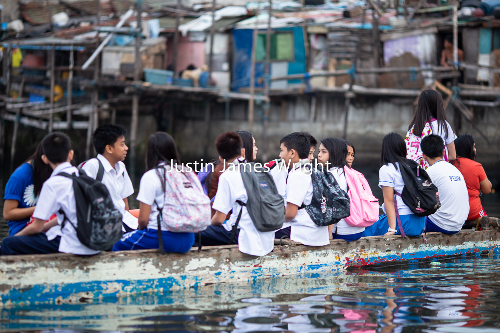Water Taxi, Navotas River, Metro Manila, Philippines   Philippine Photo 5266  If you wish to purchase a photography print of this image, or would like to license this image please contact us using the form below.  Please kindly include the Image Title and Image Ref # in your message, we will get back to you.