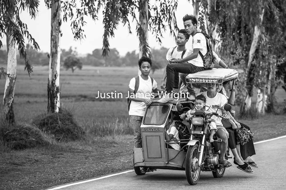 Manila Street Photography    Over loaded Tricycle, Pangasinan, Philippines.   Philippine Image 5303  If you wish to purchase a photography print of this image, or would like to license this image please contact us using the form below.  Please kindly include the Image Title and Image Ref # in your message, we will get back to you.