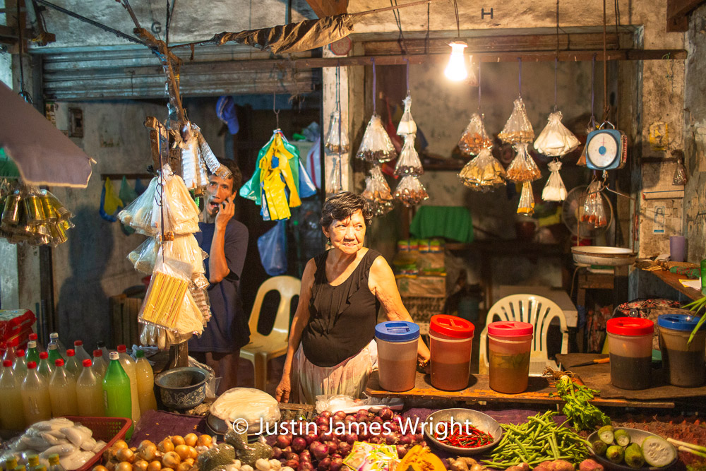 Market Vendor  - June 2013.  Canon EOS 5D Mk III, EF 35 mm F1.4L. @ F1.4, 1/200 sec.  From the Photographic Story :  A Decade on One Street.