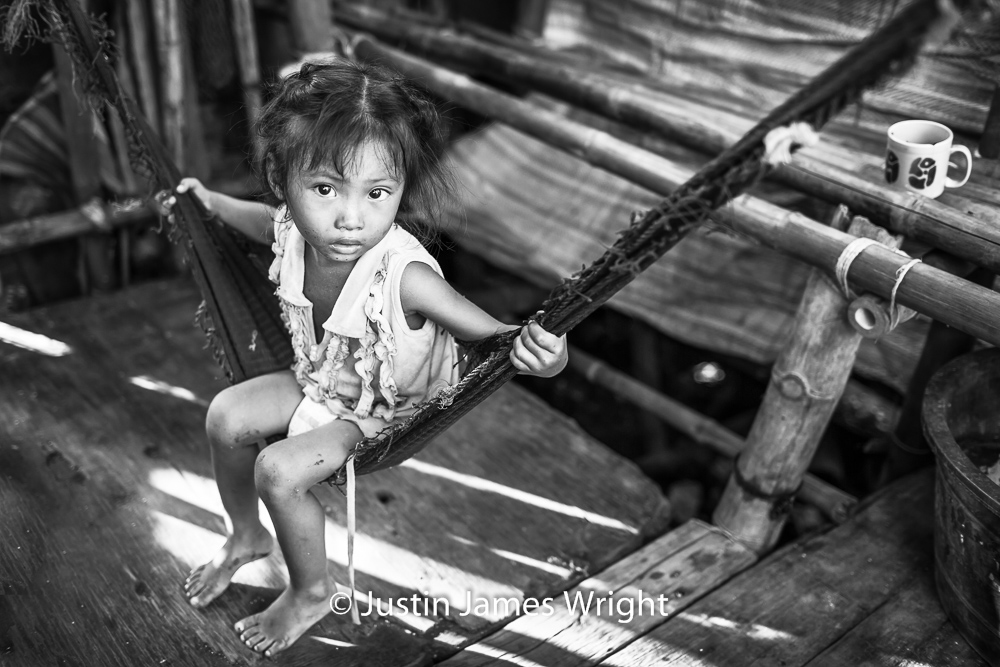 Rhea May   Left to her own devices, Rhea May swings to her 4-year-old heart's content.  Resilience - The Isla Pulo Community, Philippines.  July 2013. Canon EOS Mk III, EF 35 mm, F 2.0, 1/250 sec.