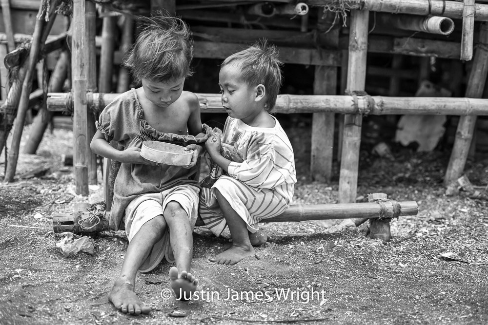 Tinder Box   What lies within is of endless intrigue to curious siblings Renlyn, eight, and Sael, five.  Resilience - The Isla Pulo Community, Philippines.  July 2013. Canon EOS Mk III, EF 50 mm, F 2.8, 1/250 sec.