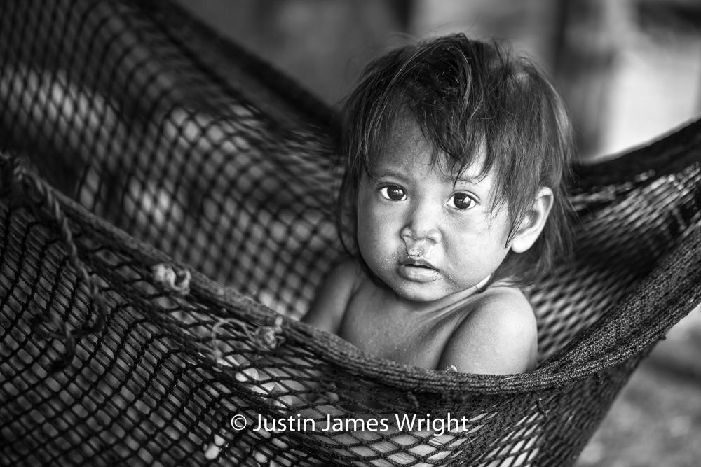 Ronalyn   At one year-old, the hammock is Ronalyn's oyster.  Resilience - The Isla Pulo Community, Philippines.  July 2013. Canon EOS Mk III, EF 100 mm, F 2.8, 1/250 sec.