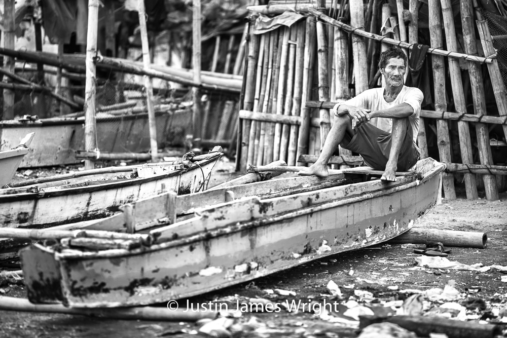 Waiting for the Tide   Resilience - The Isla Pulo Community, Philippines.  July 2013. Canon EOS Mk III, EF 135 mm, F 2.0, 1/500 sec.