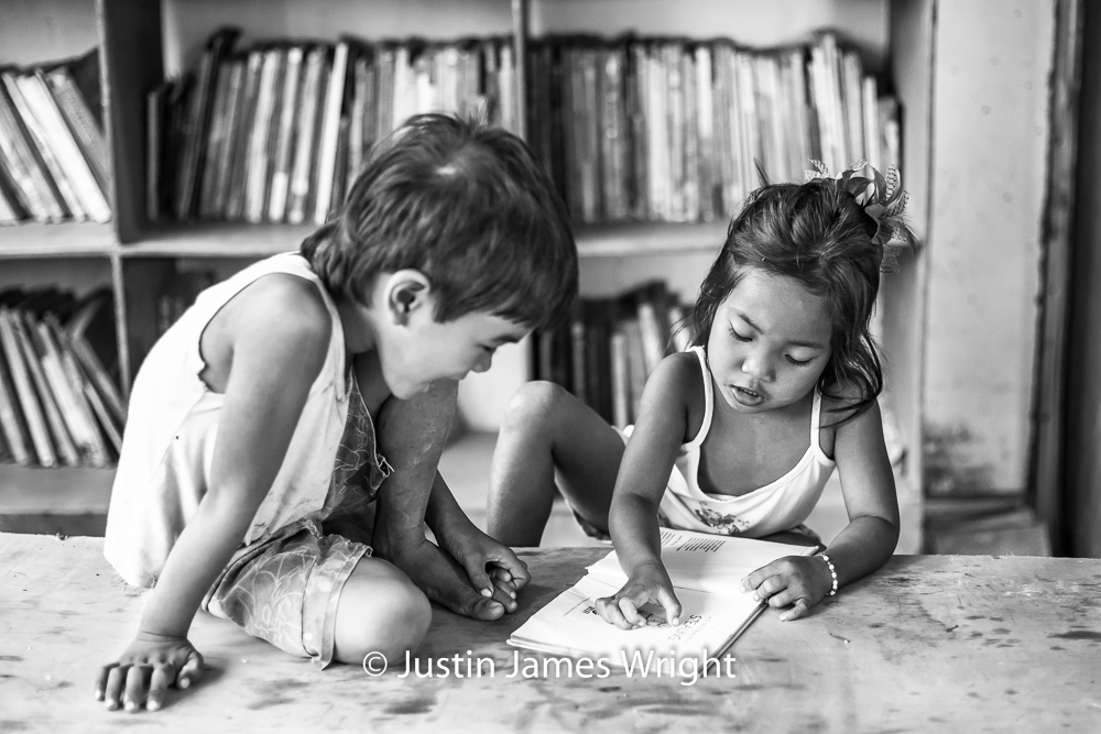 Learning to Read   The Isla Pulo Community, Metro Manila, Philippines.  February 2013. Canon EOS Mk III, EF 50 mm, F 2.0, 1/160 sec.