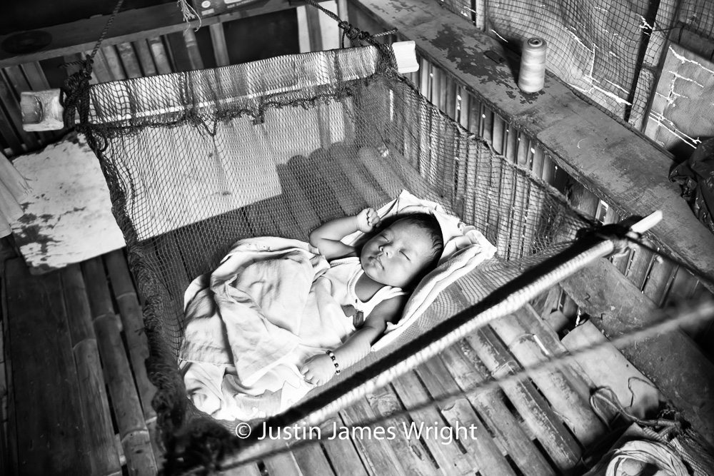 Baby Justine takes a morning nap.   The Isla Pulo Community, Metro Manila, Philippines.  January 2013. Canon EOS Mk III, EF 24 -70 mm, F 2.8, 1/100 sec.