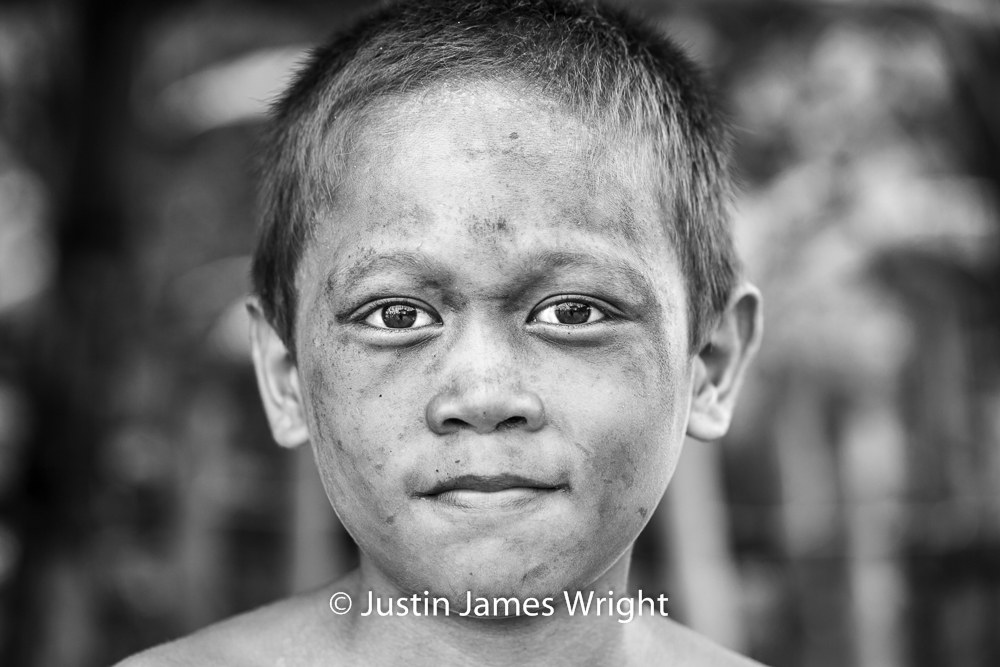 A Portrait of a Proud Filipino   The Isla Pulo Community, Metro Manila, Philippines.  July 2013.Canon EOS Mk III, EF 100 mm, F 4.0, 1/160 sec.