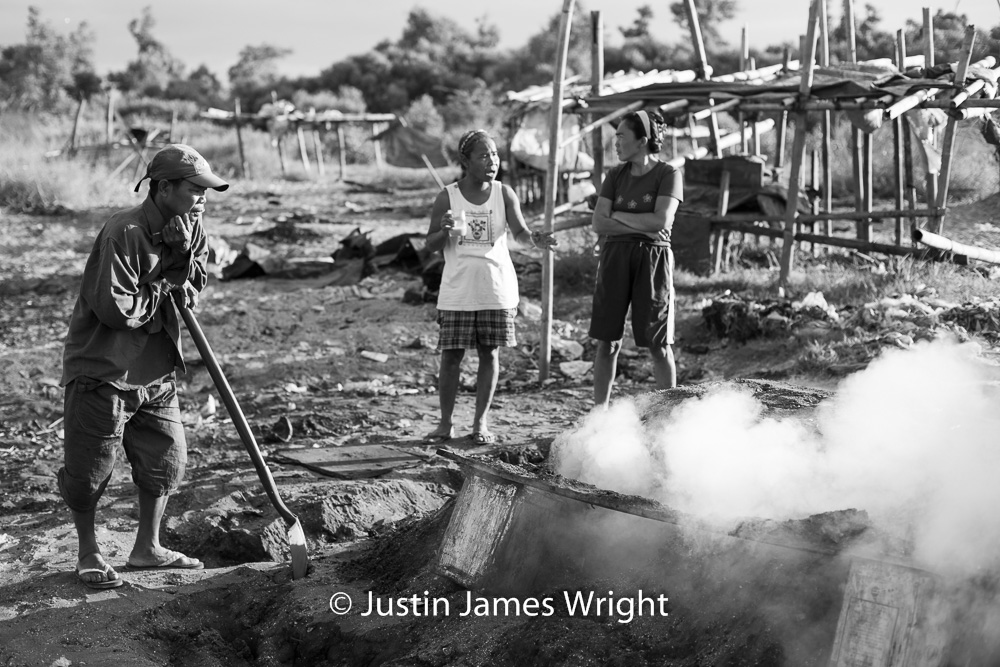 Charcoal Production   Resilience - The Isla Pulo Community, Philippines.  January 2013. Canon EOS Mk III, EF 50 mm, F 2.8, 1/1000 sec.