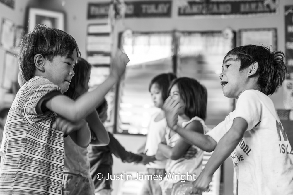 Children Enjoying Time in the Classroom   Resilience - The Isla Pulo Community, Philippines.  January 2013. Canon EOS Mk III, EF 50 mm, F 2.8, 1/160 sec.