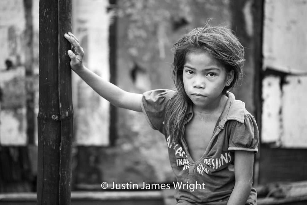 A Portrait of a Proud Filipina   The Isla Pulo Community, Metro Manila, Philippines.  August 2013. Canon EOS Mk III, EF 100 mm, F 2.8, 1/125 sec.