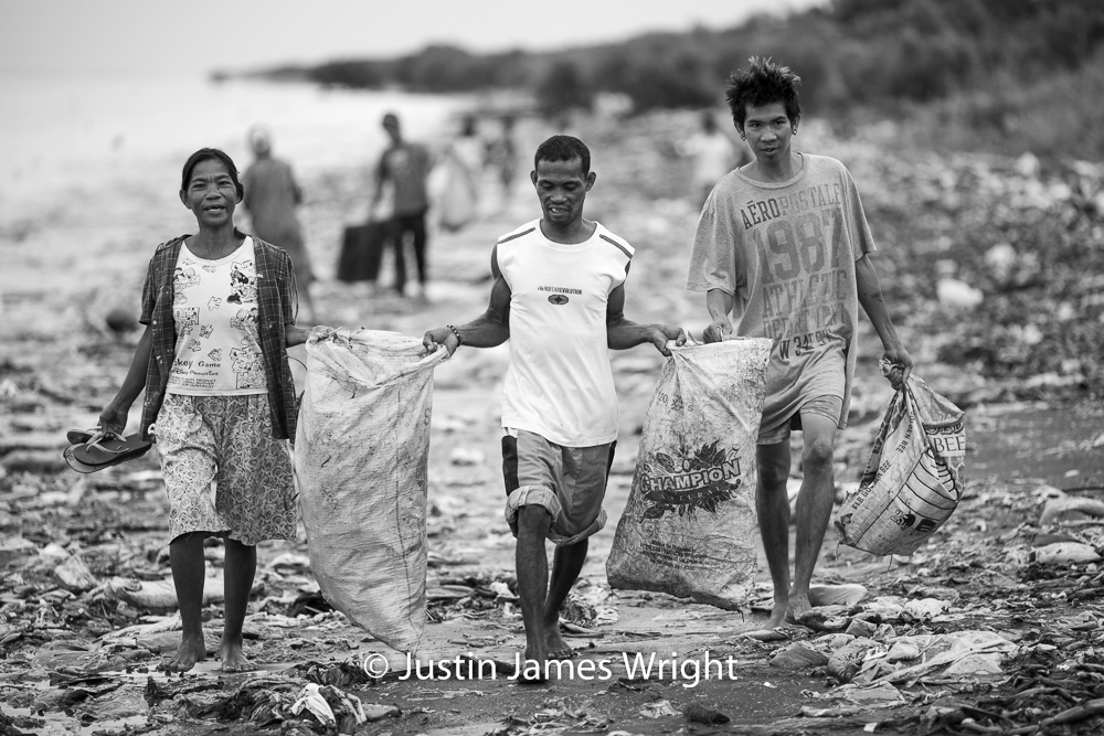 Collecting Materials for Recycling   Resilience - The Isla Pulo Community, Philippines.  July 2013. Canon EOS Mk III, EF 135 mm, F 2..0, 1/500 sec.