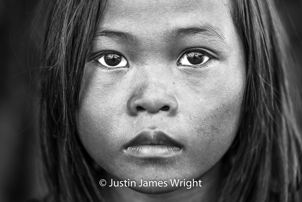 Romelyn   Windows to her soul, her eyes speak volumes and tell tales of lives lived beyond her nine years.  Resilience - The Isla Pulo Community, Philippines.  July 2013. Canon EOS Mk III, EF 100 mm, F 4, 1/60 sec.