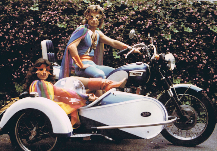 Shanti's parents on a motorcycle in costume