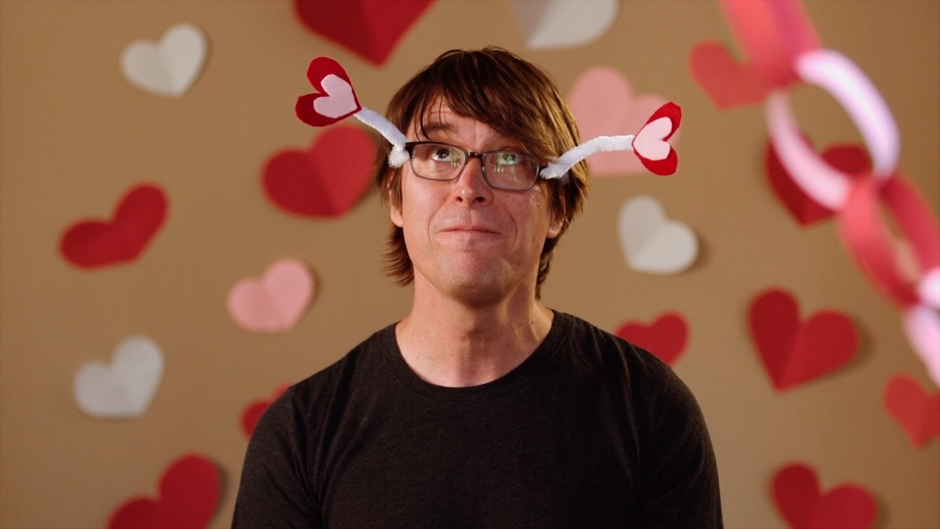 Justin Roberts with pipe-cleaner-and-paper-heart crown