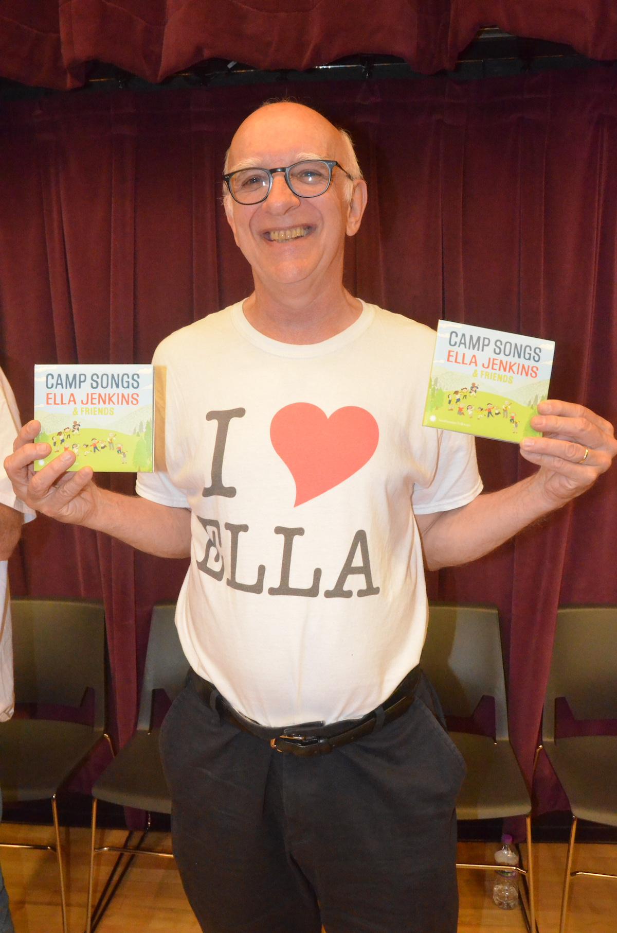 Tony Seeger holding copies of Ella Jenkins Camp Songs CDs