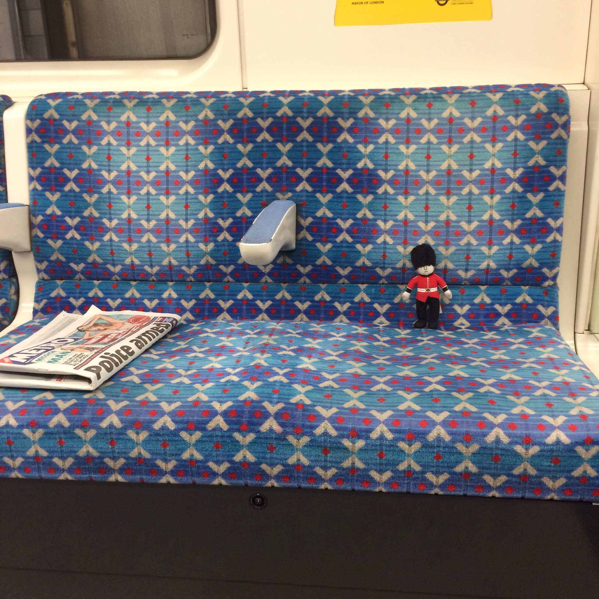 My little event buddie got his own seat on the tube to Brixton Station.